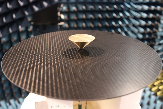 Conical Monopole Antenna on Circular CFRP Ground Plane